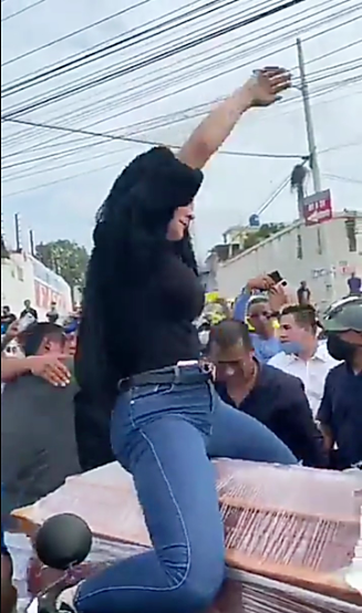 VIDEO : Woman Twerks On Top A Half -Open Coffin DURING A FUNERAL CEREMONY.